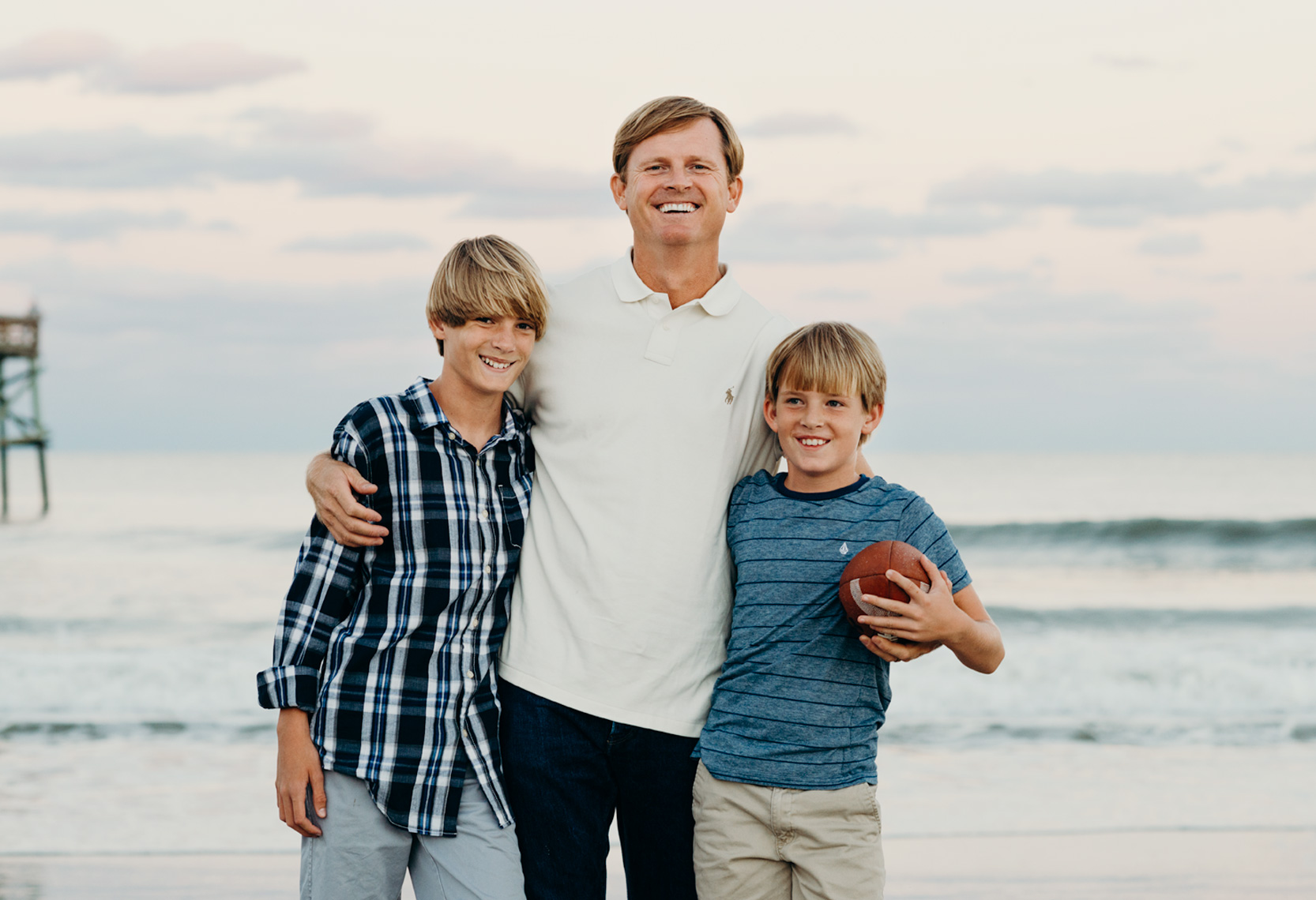 Father-Hugging-Sons-On-Beach-Amelia-Island