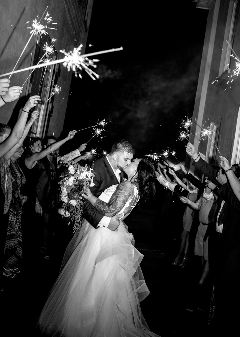 Great-Sparkler-Exit-Bride-and-groom-kissing-bw