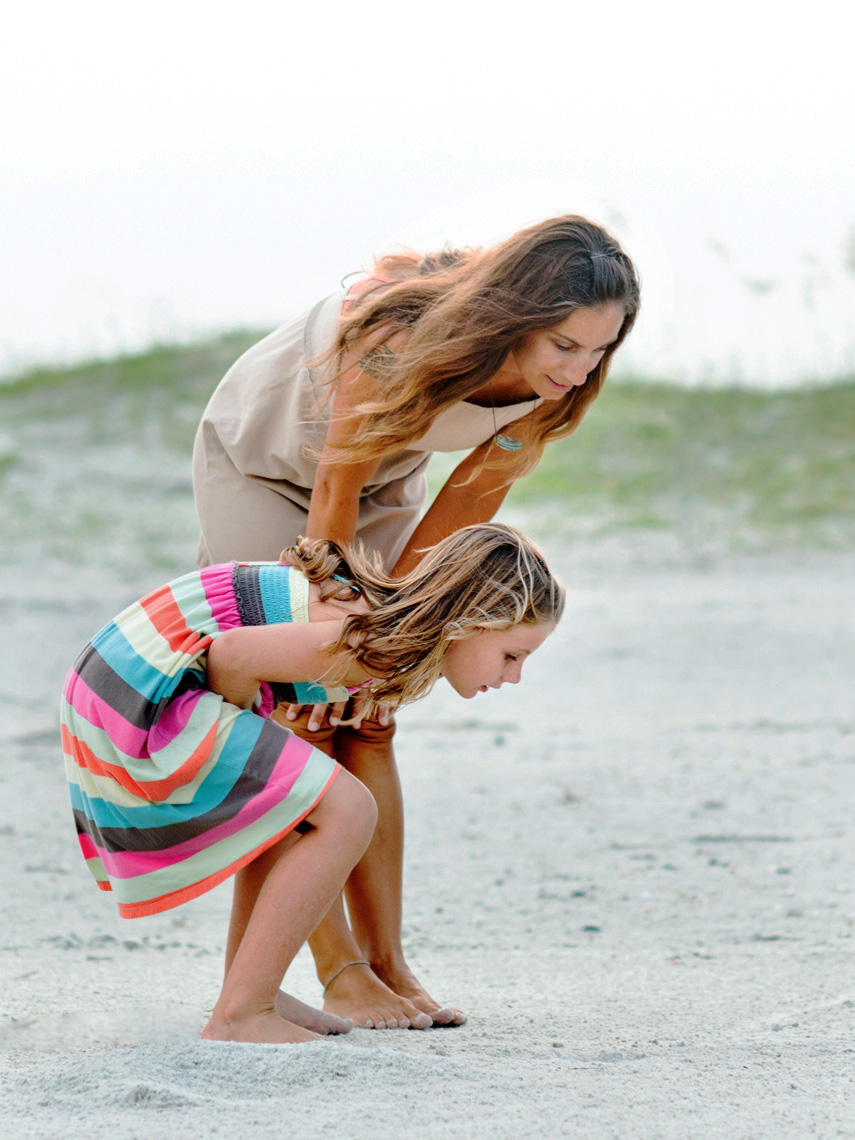 Mother-and-Daughter-Playing-on-Beach